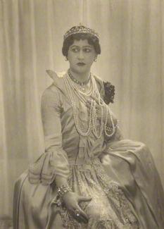 Arthur Jeffress in character as Catherine the Great, wearing crowns and tiaras